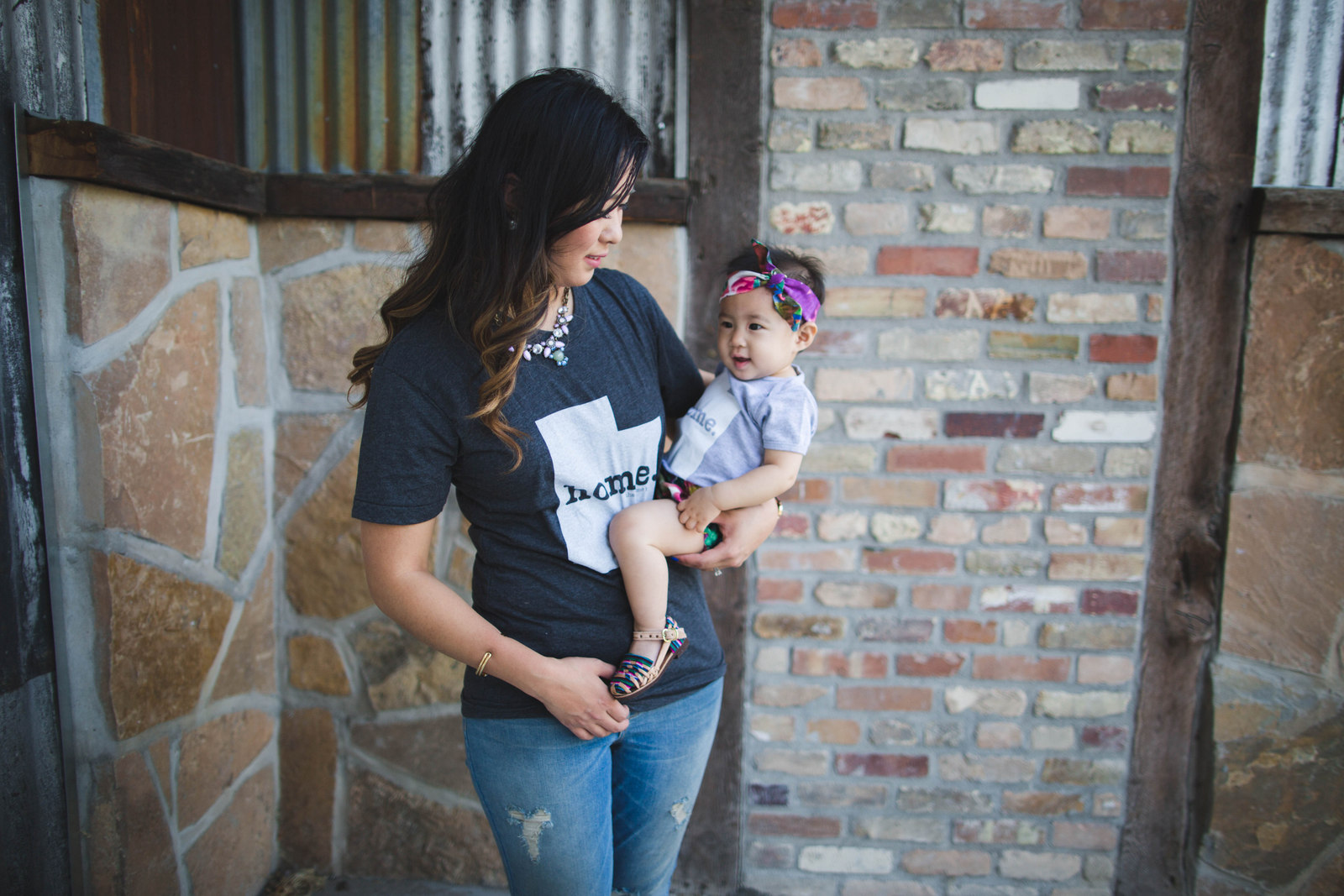 Mommy and me wearing Home tees