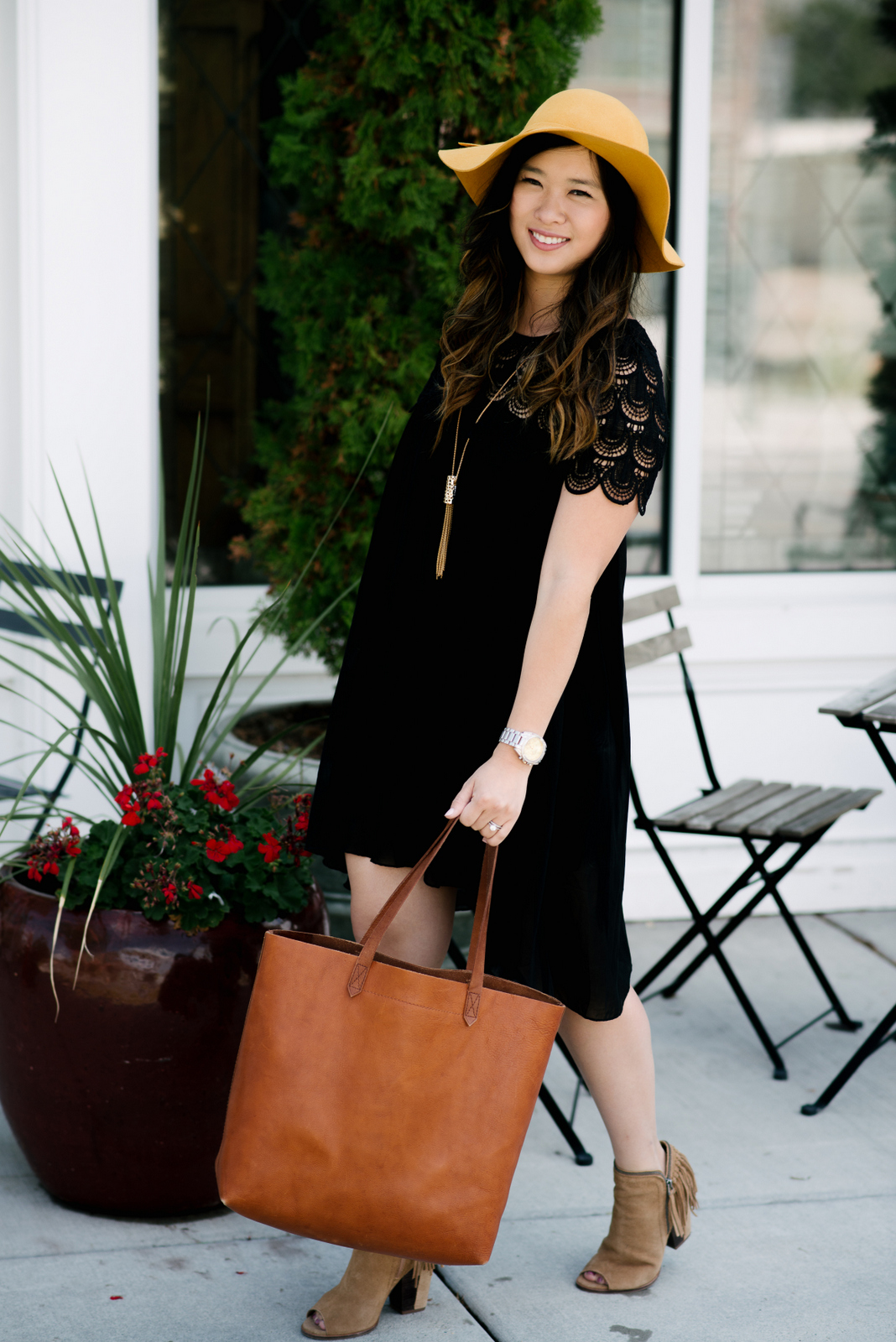 Black dress and floppy hat style