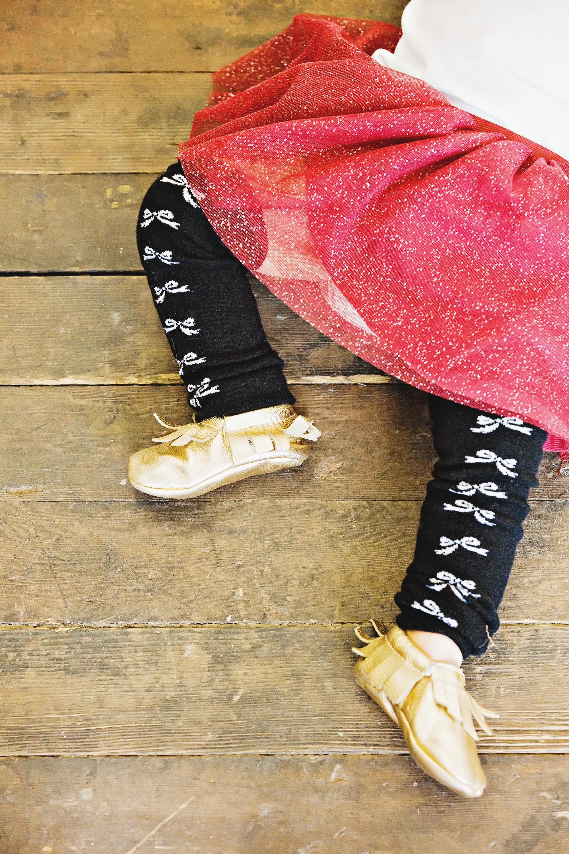 Baby girl in legwarmers