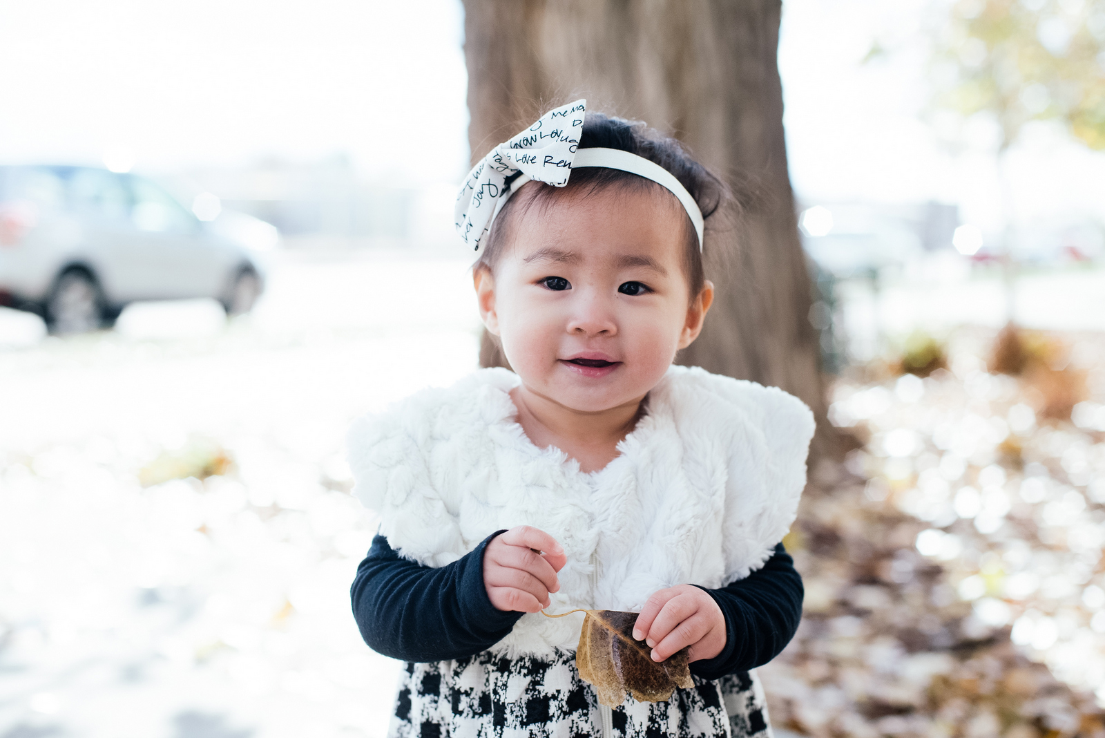 Baby girl wearing Little Cans headband
