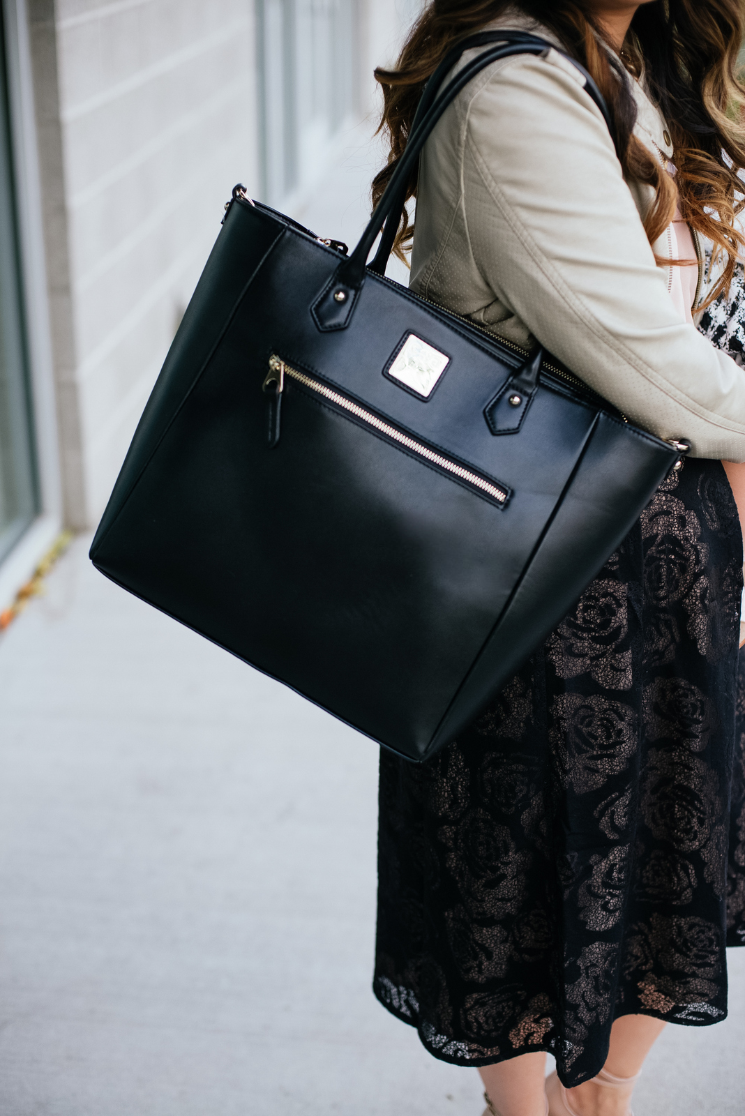 Mom wearing Charlotte and Asher diaper bag