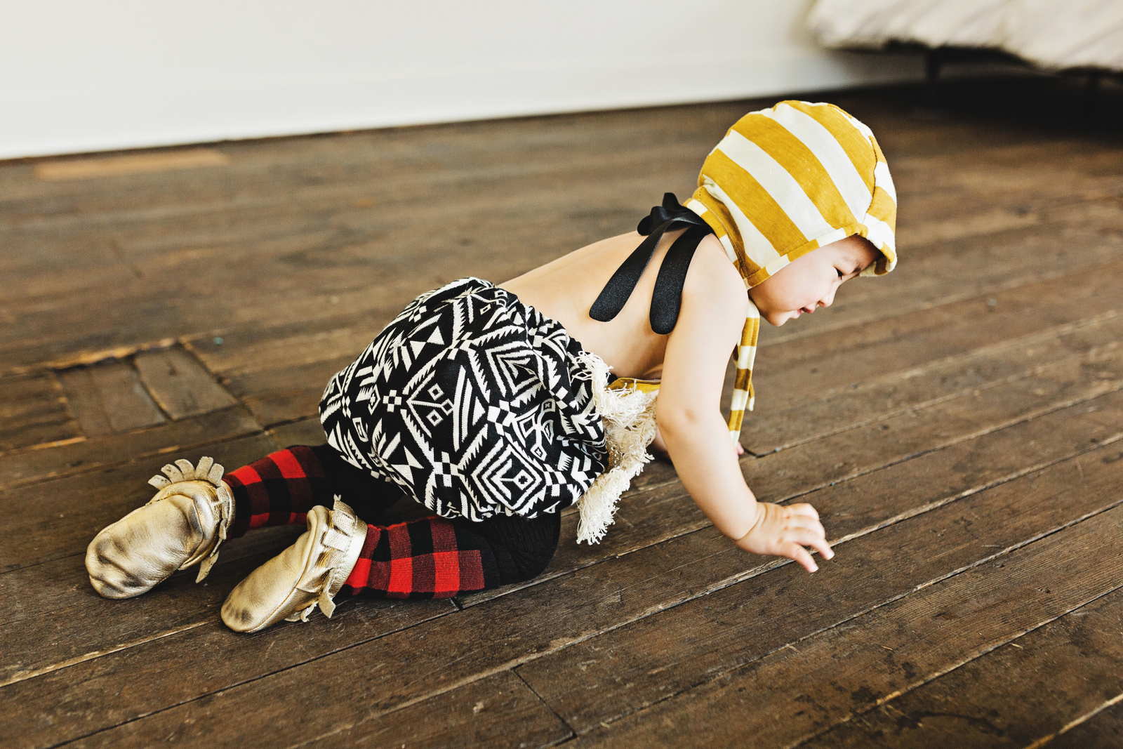 Baby girl styling buffalo plaid, aztec and stripes
