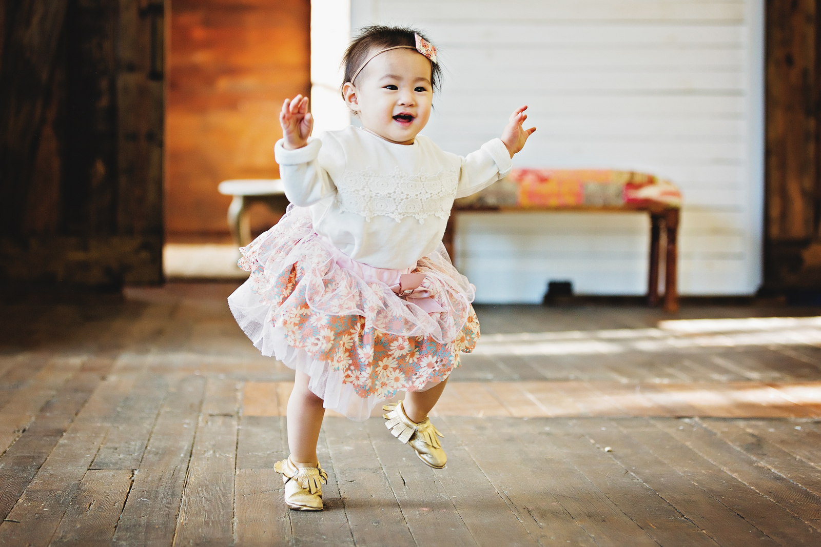 Baby girl wearing sweater and tulle skirt