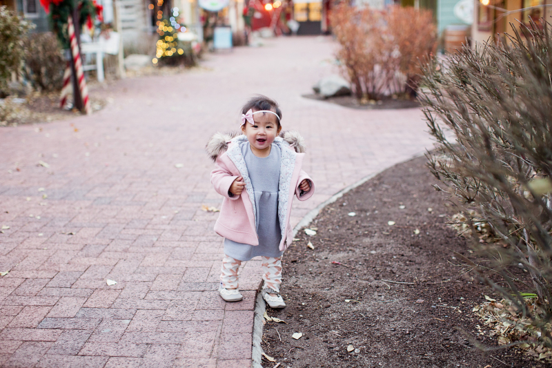 Toddler girl wearing pink and grey