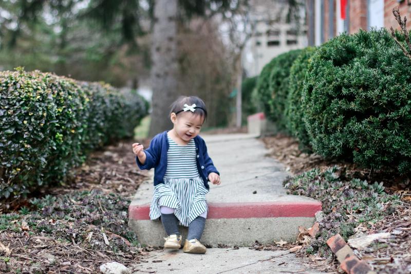 Toddler wearing striped dress