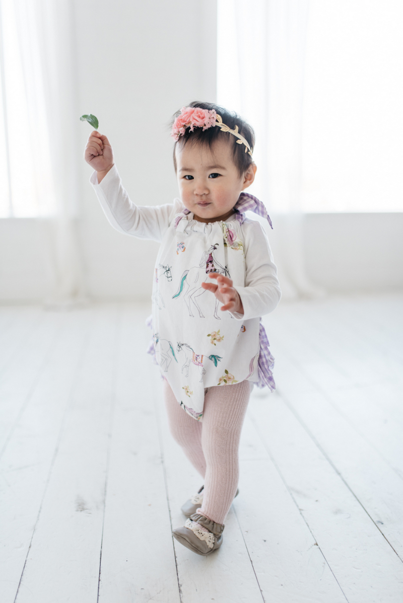 Baby girl styling a romper