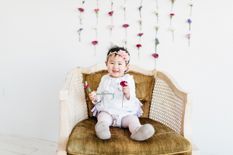 Baby girl with flowers