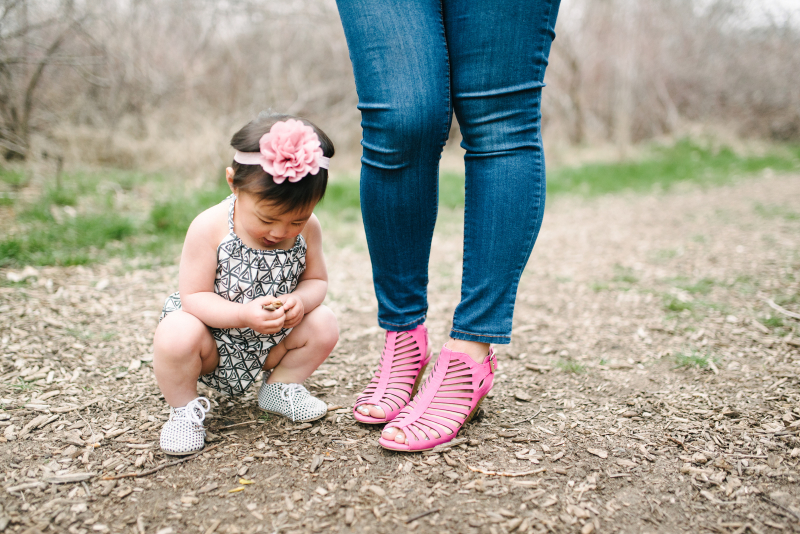 Baby girl and mom's shoes