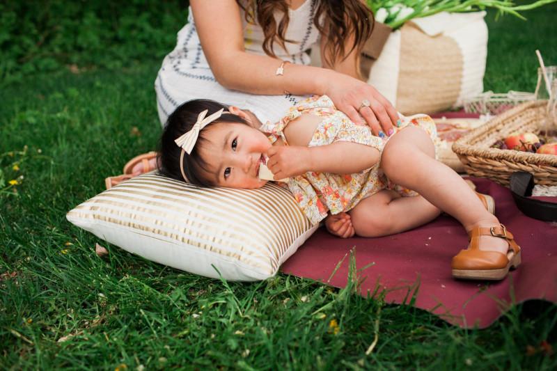 Baby wearing Les Petit Darlings