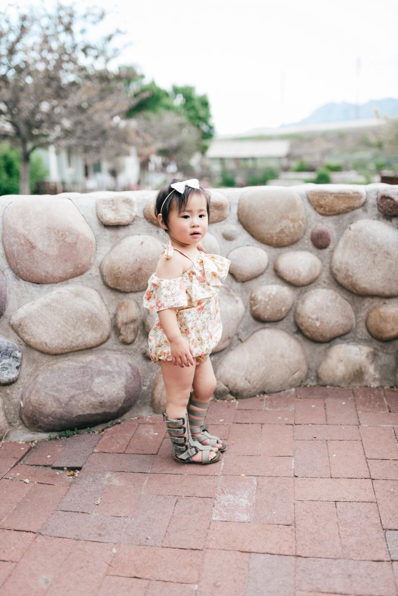 Baby girl wearing Les Petits Darlings romper