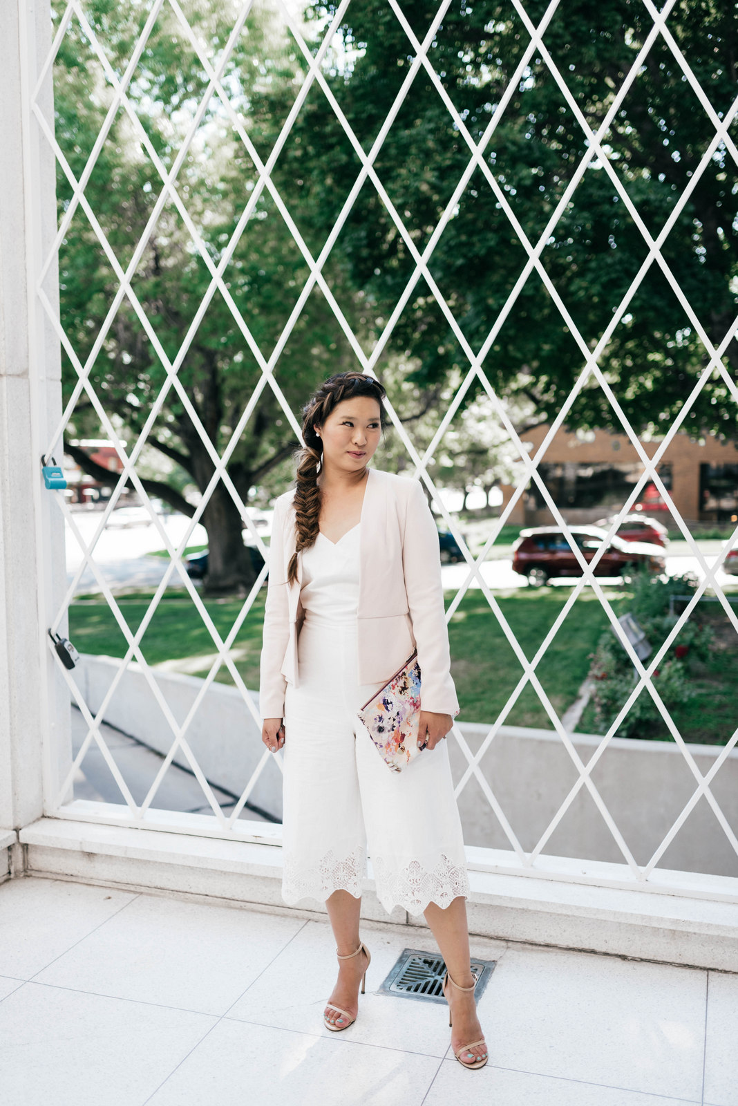 White jumpsuit and pink blazer