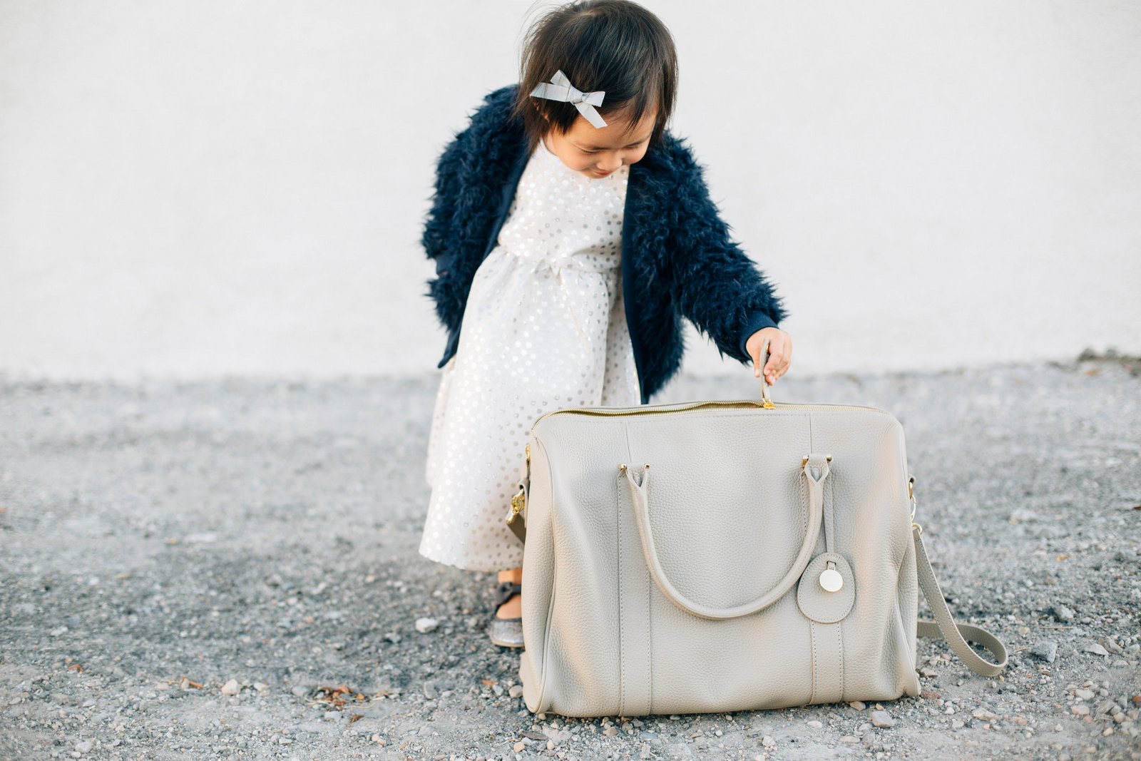 Baby girl with PacaPod diaper bag