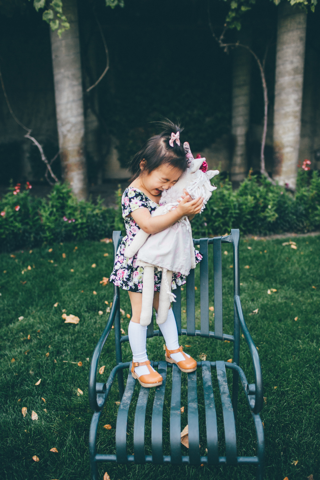 Toddler girl hugging unicorn