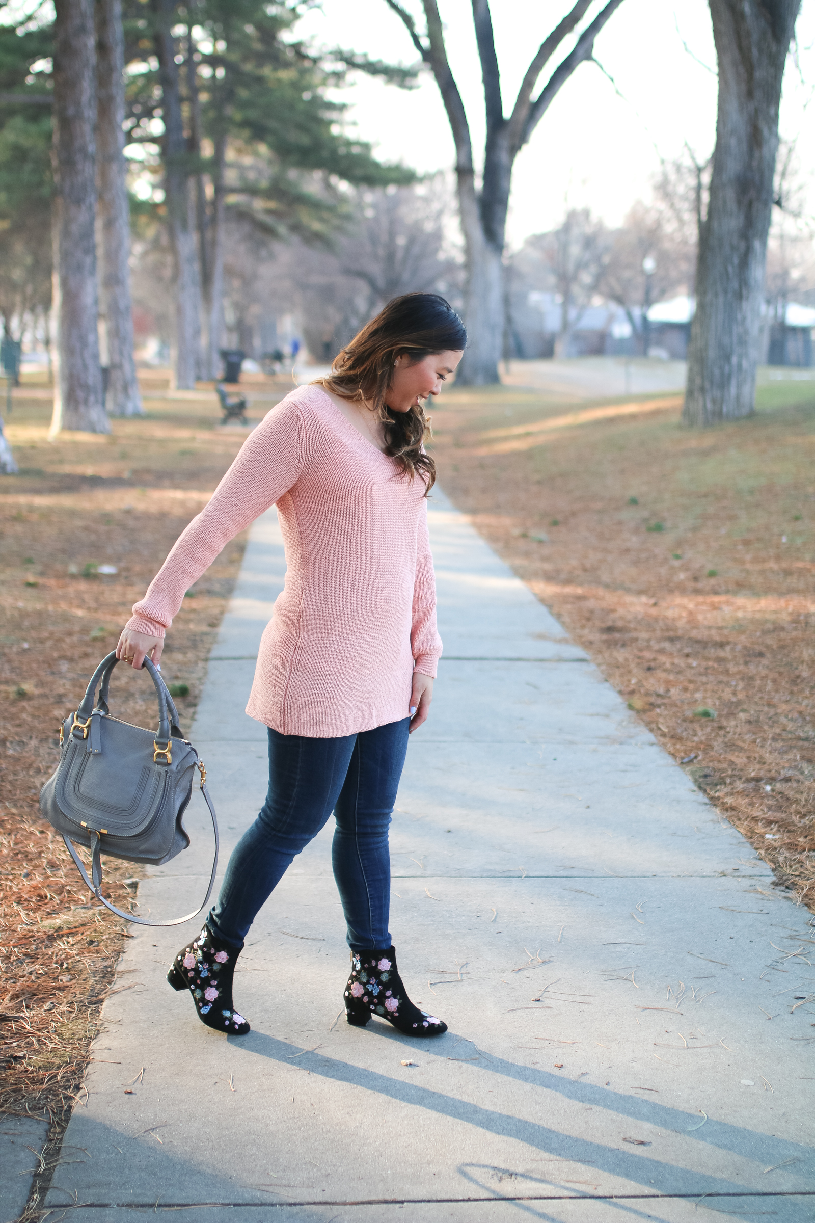 How to wear floral booties and a lace up sweater
