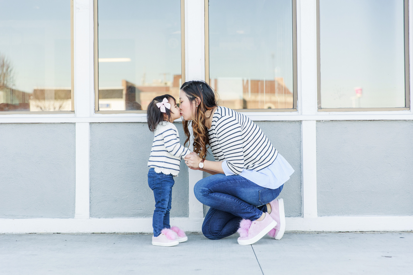 Mommy and me outfits: striped shirts and pom pom shoes