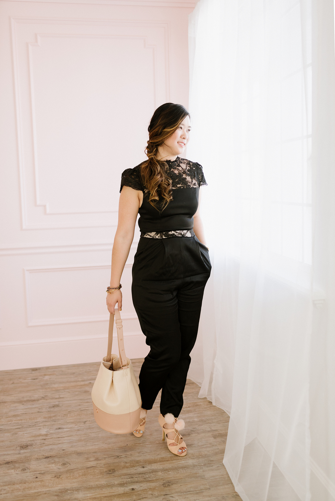 Black Jumpsuit and Blush Bag by fashion blogger Sandy A La Mode