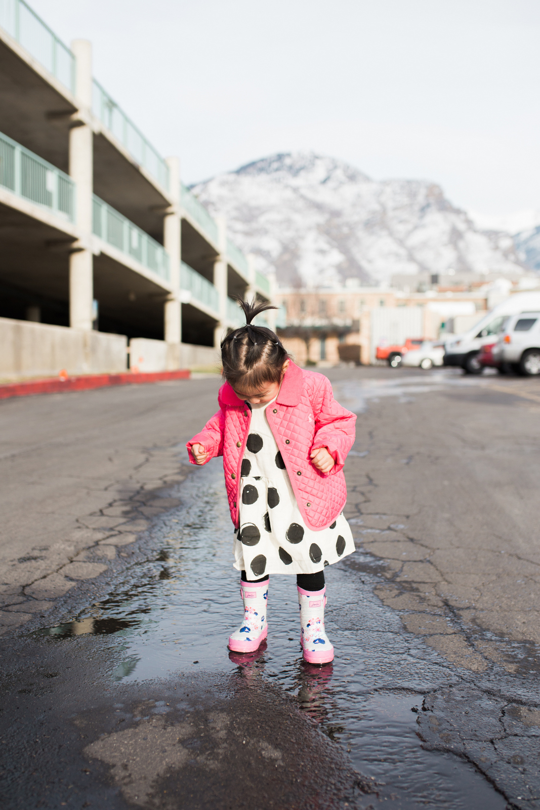 Toddler girl in rainboots