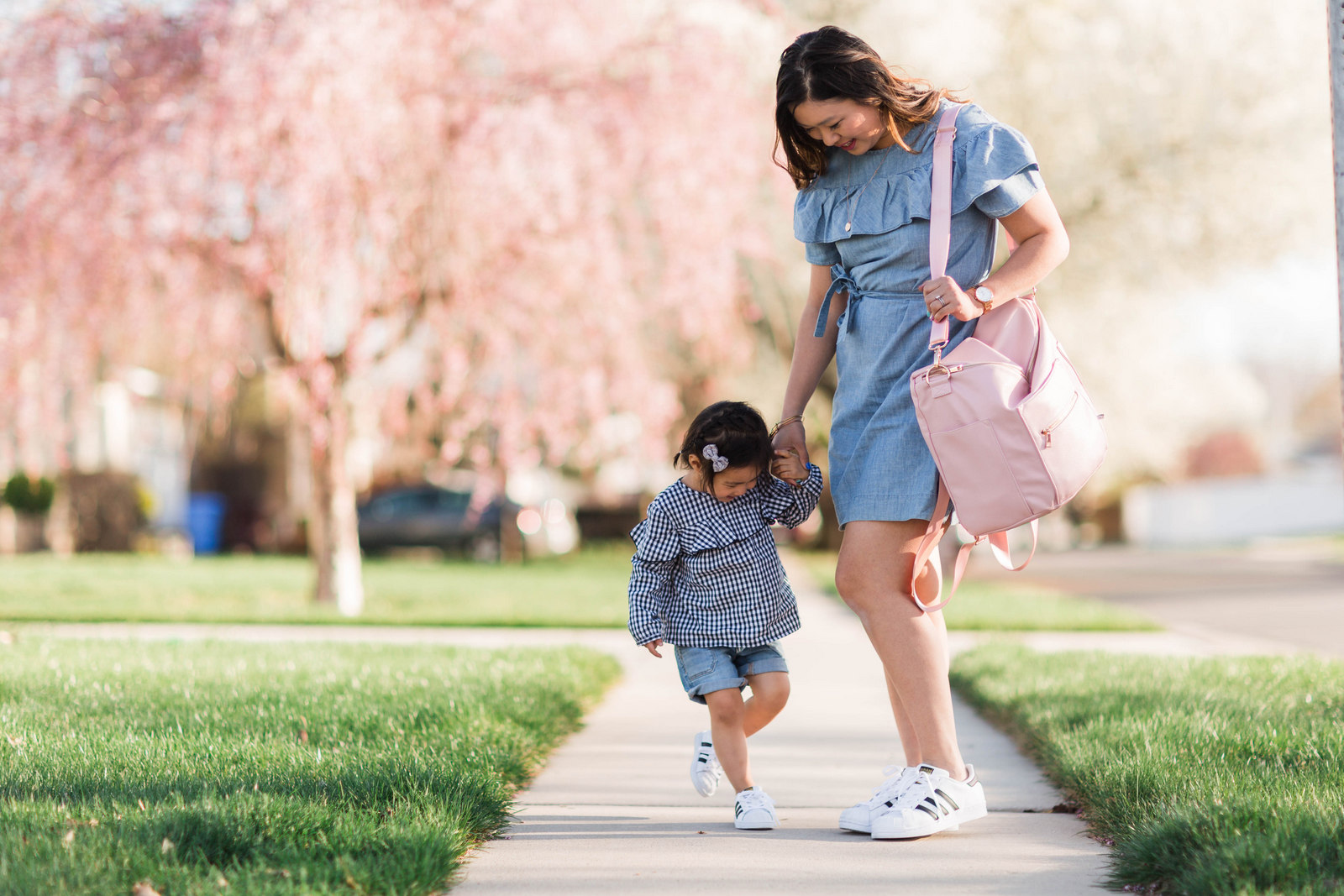 Mommy and Me Outfit: Ruffles and Adidas Superstars Black and White by fashion blogger Sandy A La Mode