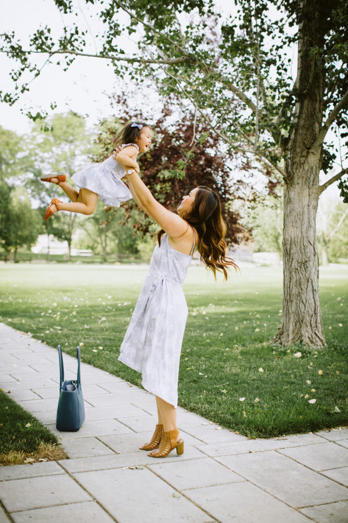 Mommy and Me Outfits: Grey Floral Dresses by Utah fashion blogger Sandy A La Mode