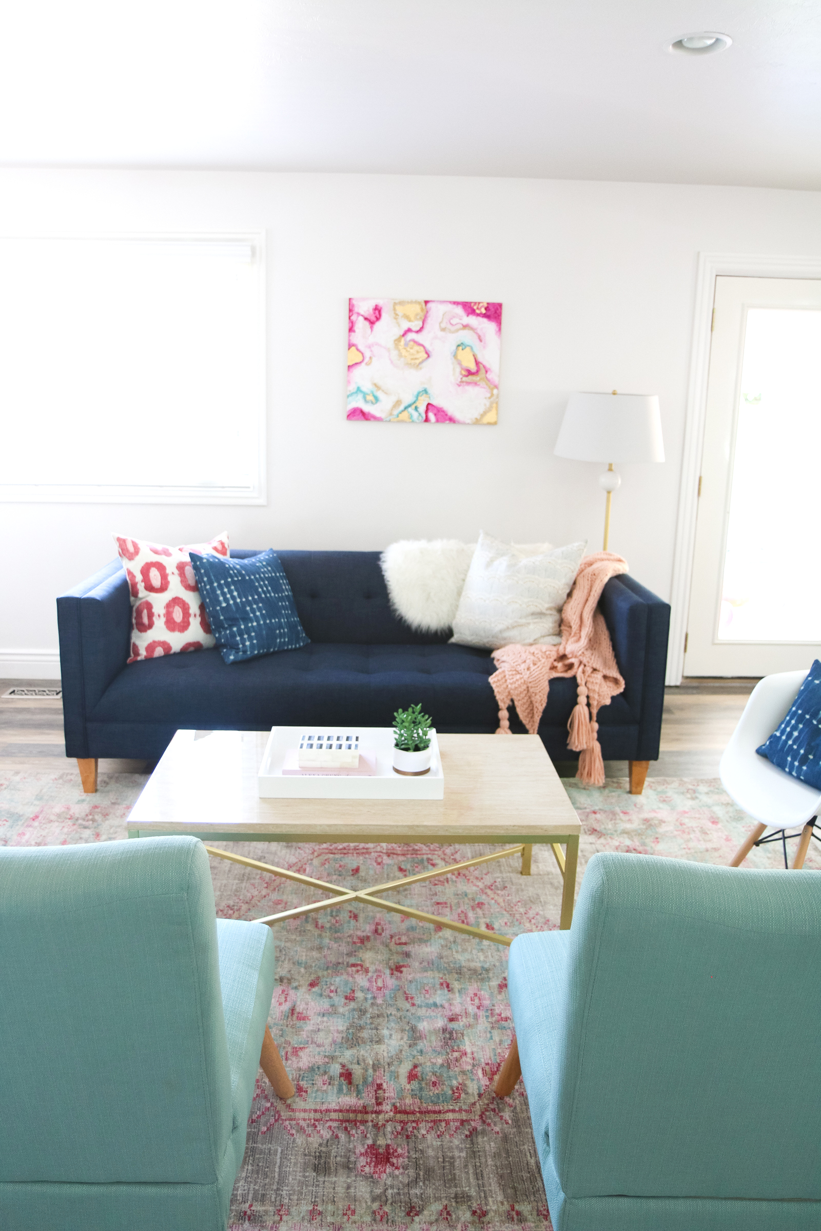 Our New Home Big Reveal: How We Styled Our Navy Couch by popular Utah blogger Sandy A La Mode