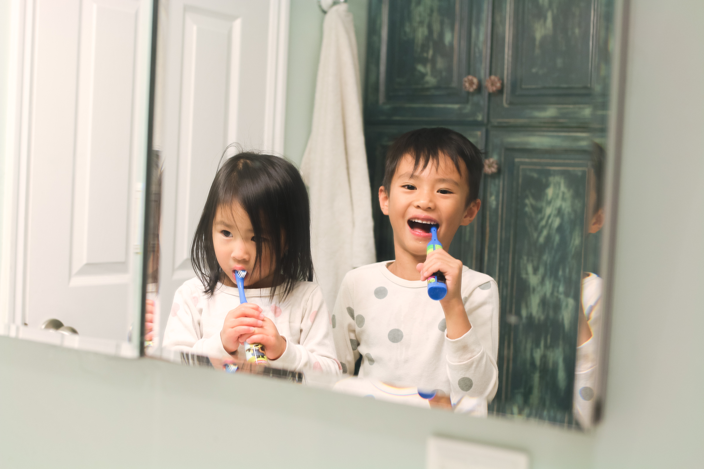 Child Brushing Teeth: How I Got My Kids To Brush Their Teeth For Two Whole Minutes by Utah lifestyle blogger Sandy A La Mode