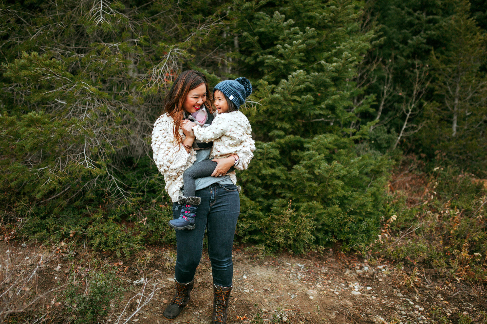 Mommy and Me Outfits: Pom Pom Sweater + Winter Boots by Utah fashion blogger Sandy A La Mode