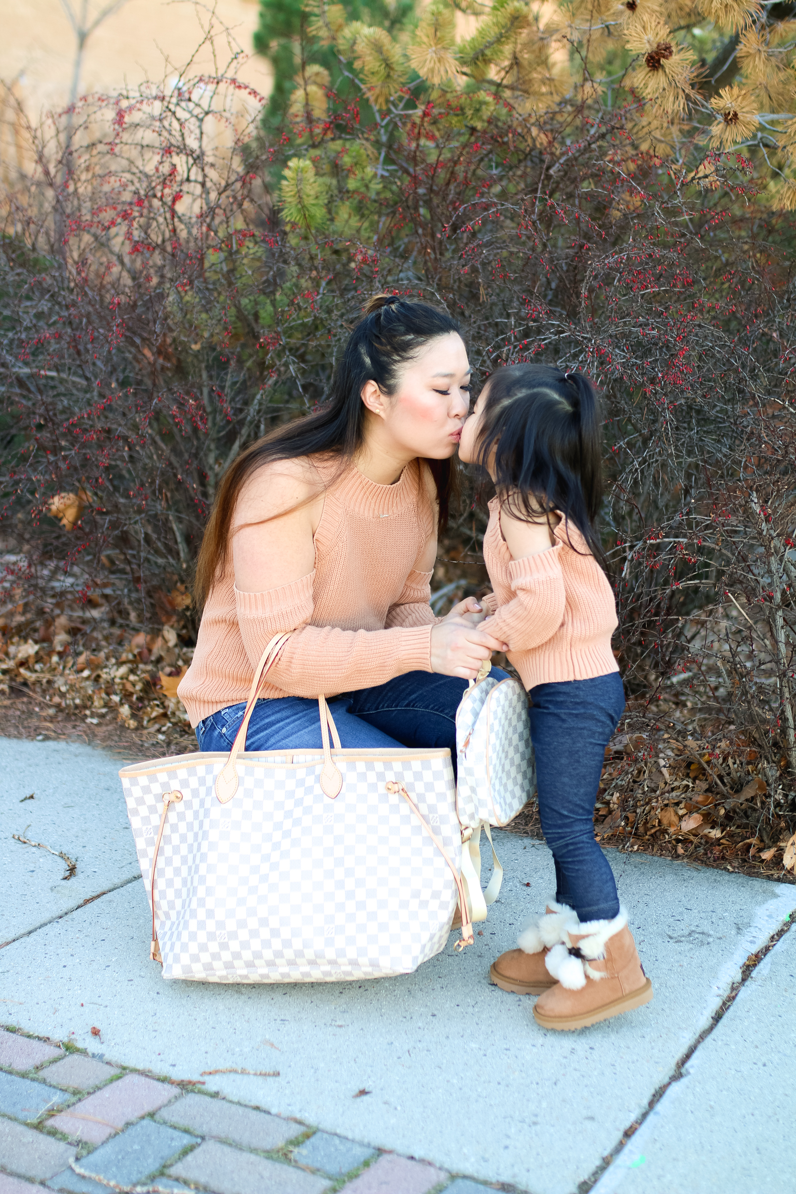 Mommy and Me Outfit: Cold Shoulder Tops + Pom Pom UGGs by popular Utah style blogger Sandy A La Mode