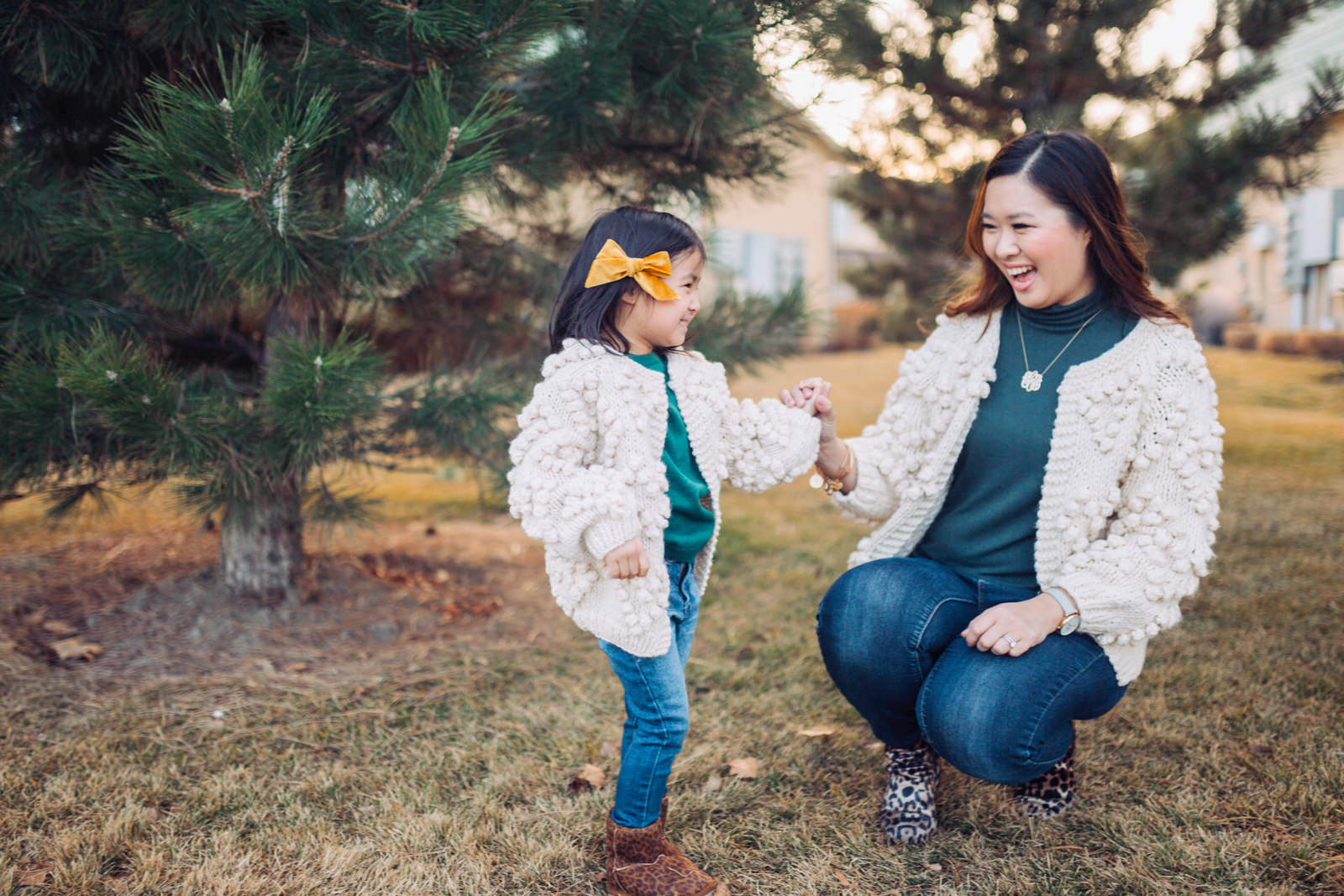 Mommy and Me Outfit: Pom Pom Cardigan and Leopard Boots by popular Utah style blogger Sandy A La Mode